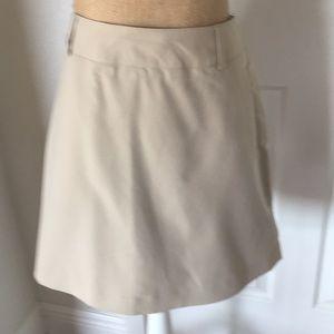 Tan Skort size 10-skirt with shorts underneath